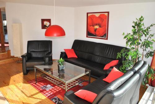 Ein Sitzbereich in der Unterkunft Ferienwohnung Warnemünde Altstadt (RC)