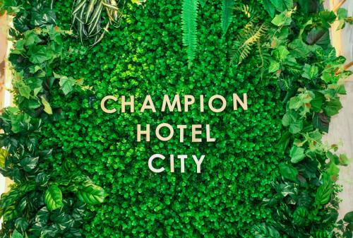A certificate, award, sign, or other document on display at Champion Hotel City (SG Clean, Staycation Approved)
