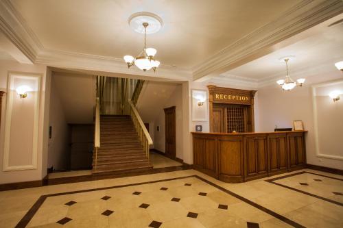 Лобби или стойка регистрации в Abakan Hotel