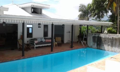 The swimming pool at or near The Station Retreat Hotel Seychelles