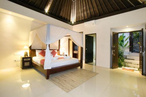 Ein Zimmer in der Unterkunft Lotus Villa Ubud