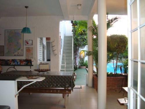 Área de negócios e/ou sala de conferências em Chale Mineiro Hostel & Pousada