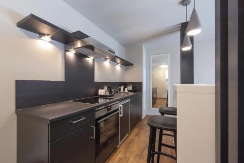 A kitchen or kitchenette at Design & Lifestyle Hotel Estilo
