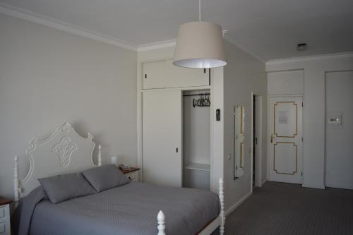 Un ou plusieurs lits dans un hébergement de l'établissement Residencial Centro Comercial Avenida Bragashopping