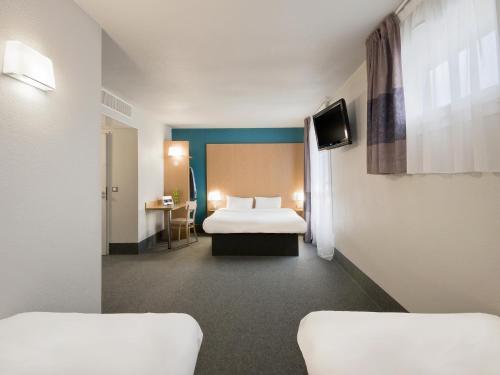 A room at B&B Hôtel Grenoble Centre Alpexpo