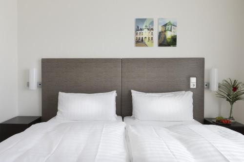 Cama o camas de una habitación en Good Morning+ Nyköping