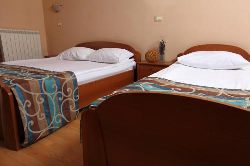A bed or beds in a room at Bed and Breakfast Malovec