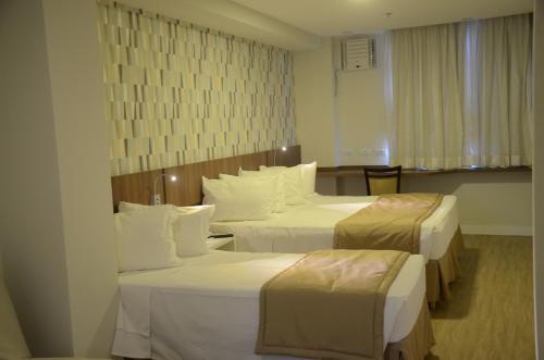 Cama ou camas em um quarto em Casa Nova Hotel