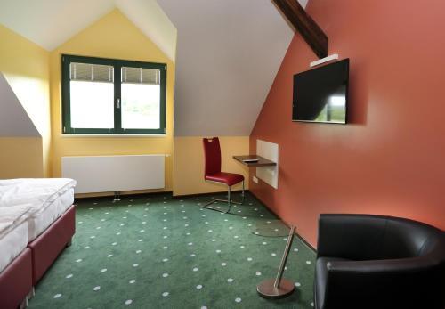 Lounge oder Bar in der Unterkunft Apartments Golfpark Schlossgut Sickendorf