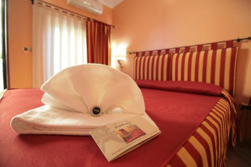 A bed or beds in a room at Airport Hotel