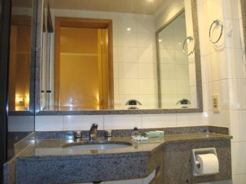 A bathroom at Flat Apart-Hotel em Goiânia