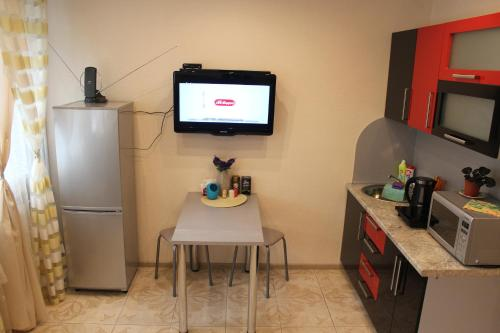 A kitchen or kitchenette at Apartments 4 Mikrorayon