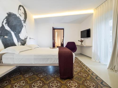 A room at Duomo Suites & Spa