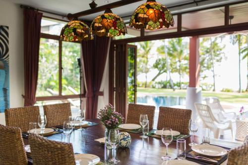 A restaurant or other place to eat at Amatapura Beachfront Villa 12, SHA Certified