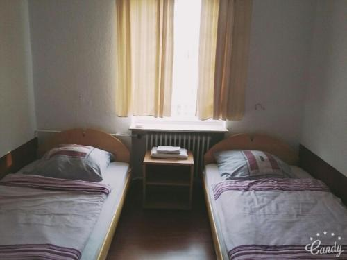 A bed or beds in a room at Sanmaru