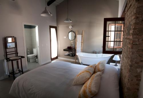 A bed or beds in a room at Patio de Arance