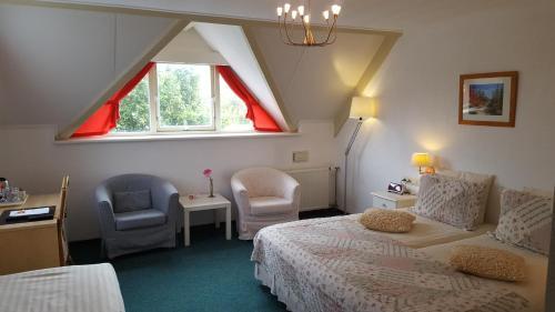 Un ou plusieurs lits dans un hébergement de l'établissement Het Uilenbos
