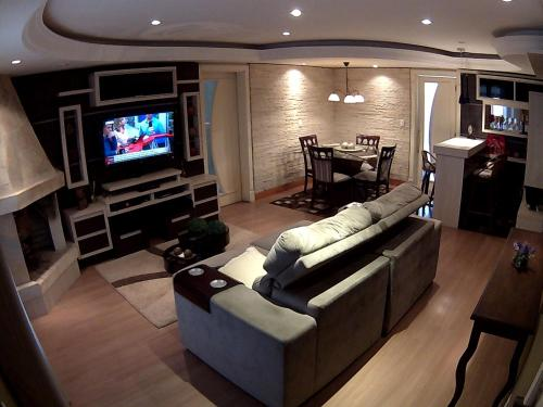 A seating area at Apartamento Lindo Centro de Canela