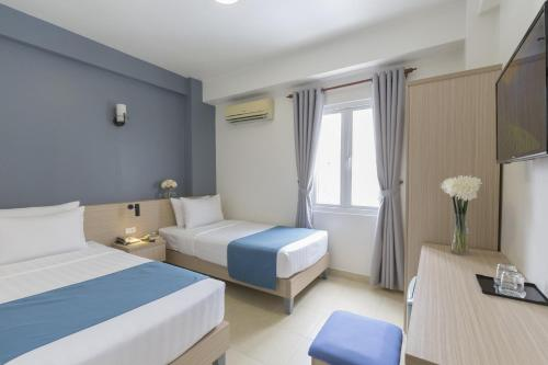 A bed or beds in a room at Meraki Boutique Hotel- Bùi Viện Street