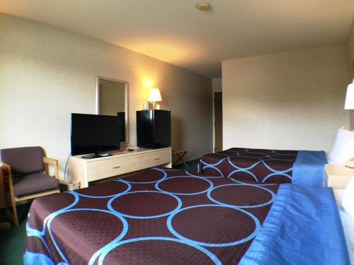 A bed or beds in a room at Super 8 by Wyndham Canandaigua