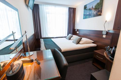 Una habitación en Hotel City Garden Amsterdam