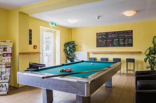 A pool table at a&o Weimar