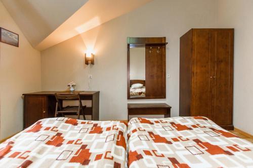 Кровать или кровати в номере Vershina Mini-hotel