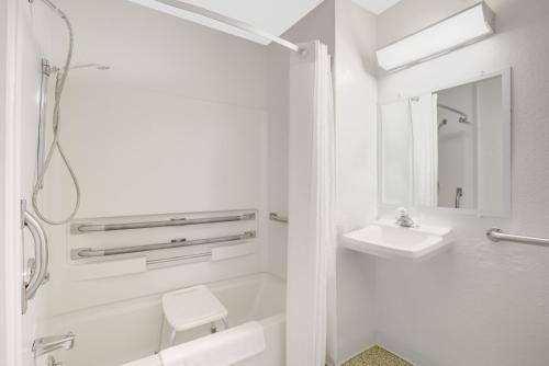 A bathroom at Super 8 by Wyndham Lake George/Warrensburg Area