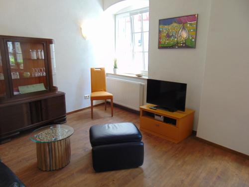 De lounge of bar bij Ferienwohnung Bergblick /Moseltal