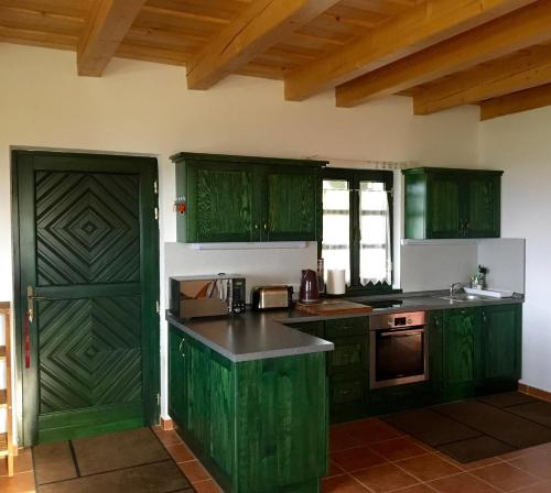 A kitchen or kitchenette at Somlo Wineshop Guesthouse