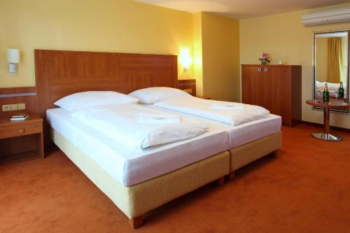 Postel nebo postele na pokoji v ubytování Wellness Resort Energetic