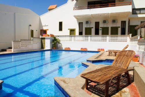 The swimming pool at or near Casa Taller Ramirez