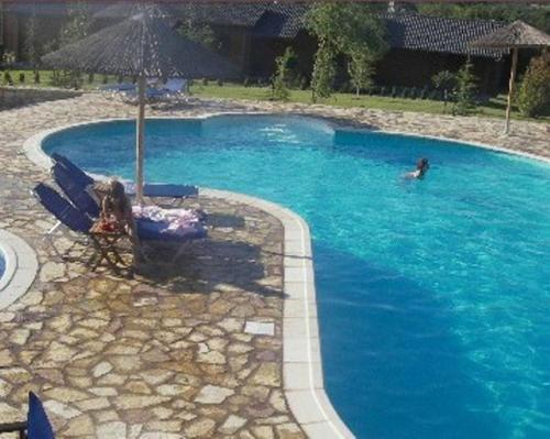 Πισίνα στο ή κοντά στο Το Ξύλινο Χωριό
