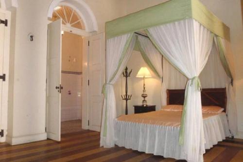 Cama ou camas em um quarto em Casa Frankie