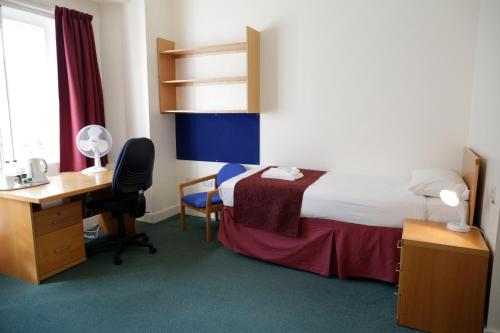 A bed or beds in a room at Beit Hall