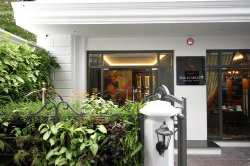 The facade or entrance of The Scarlett Boutique Hotel