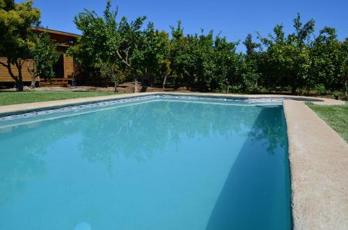 The swimming pool at or near Cabañas SPA Olmue