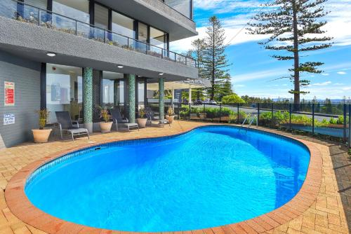 The swimming pool at or near ibis Styles Port Macquarie