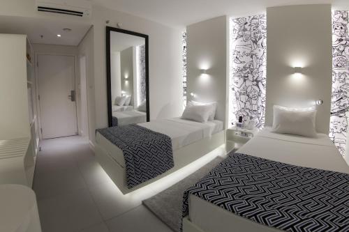 Cama ou camas em um quarto em ibis Styles Boa Vista