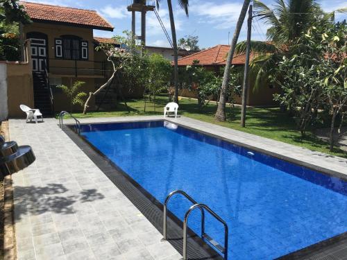 The swimming pool at or close to Abeysvilla