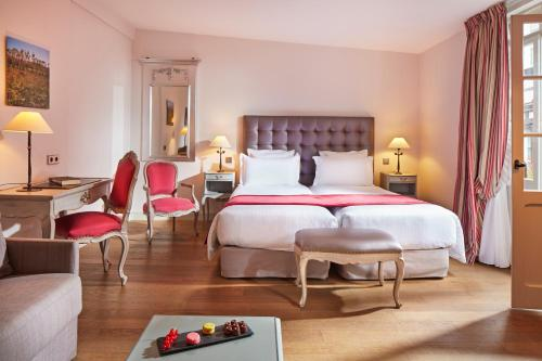 A bed or beds in a room at Hotel Cour du Corbeau Strasbourg - MGallery