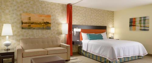 A bed or beds in a room at Home2 Suites by Hilton Alexandria