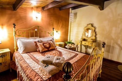 Ένα ή περισσότερα κρεβάτια σε δωμάτιο στο Camelia Suites
