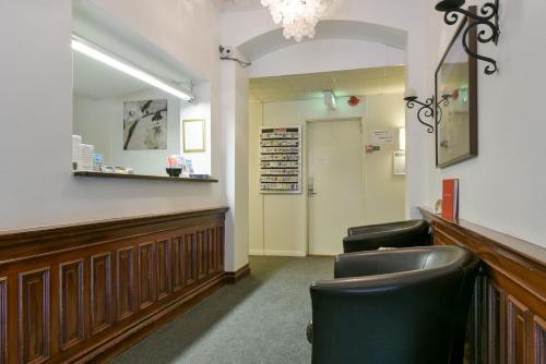 The lobby or reception area at Hotel Bema