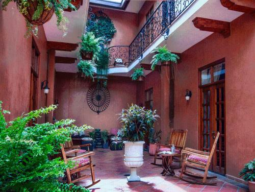 A porch or other outdoor area at La Isabela Suites