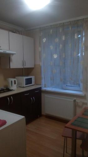 A kitchen or kitchenette at Nocturne Apartment