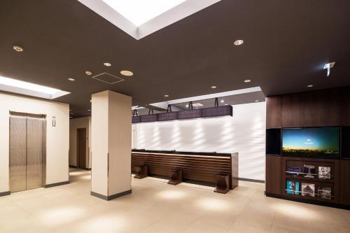 The lobby or reception area at HOTEL MYSTAYS Yokohama Kannai