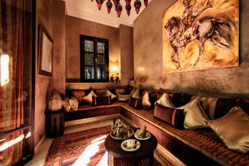 The lounge or bar area at Riad Kheirredine