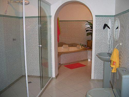 A bathroom at CanaVille Design Hotel