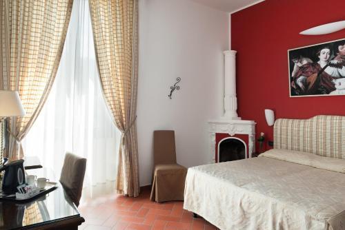 Un ou plusieurs lits dans un hébergement de l'établissement Hotel Caravaggio